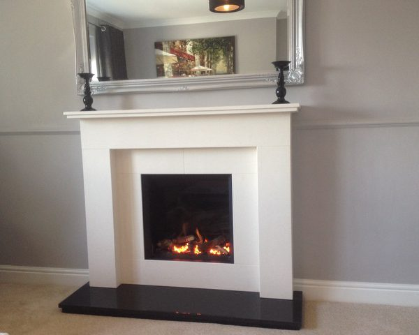 Studio Slimline Balanced flue fire in Stone Henge fireplace