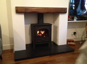Stove and wooden beam